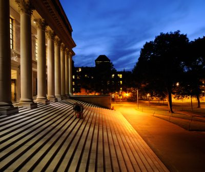 Harvard University library and campus at night. Success in education and tourist attraction in Cambridge, Massachusetts.